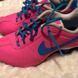 Neon pink and electric blue Nike Shox